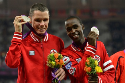 Jason Dunkerley and his guide Joshua Karanja receive the Silver Medal in the Men's 5000m T11 final on July 9, 2012 at the London Paralympic Games in the Olympic Stadium. (Photo: Phillip MacCallum/Canadian Paralympic Committee)