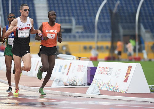 Jason Dunkerley and his guide Josh Karanja compete in the Men's 5000m T11 in the CIBC Athletics Stadium during the Toronto 2015 Parapan American Games. (Photo credit: Matthew Murnaghan/Canadian Paralympic Committee)
