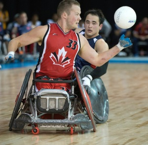MISSISSAUGA, ON, AUGUST 12, 2015. Wheelchair Rugby - Canada vs USA in preliminary action. USA won the game 60-59 in double overtime - Zak Madell. Photo: Dan Galbraith/Canadian Paralympic Committee