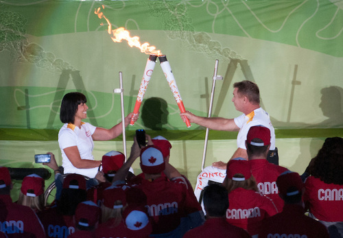 Rick Hansen passes the flame to Chantal Petitclerc during the Opening Ceremonies for the Toronto 2015 Parapan Ams