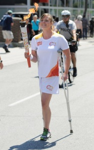 Assistant Chef de Mission Stephanie Dixon carries the torch in Toronto in 2015.