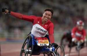 Chantal Petitclerc wins gold in the 200 metre race at the 2004 Paralympic Games in Athens, Greece.