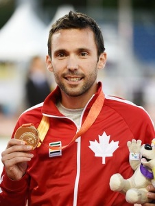 Toronto, ON - Aug 12 2015 - Guillaume Ouellet receives his Gold Medal for the Men's 1500m T13 in the CIBC Athletics Stadium during the Toronto 2015 Parapan American Games (Photo: Matthew Murnaghan/Canadian Paralympic Committee)